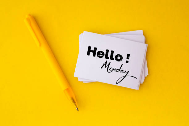 the yellow pen and stacking of  white business card with hello monday message on vibrant yellow background , cheerful for happy working time  monday concept - monday motivation stock photos and pictures