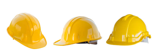 the yellow safety helmet isolated with white background - kask budowlany zdjęcia i obrazy z banku zdjęć