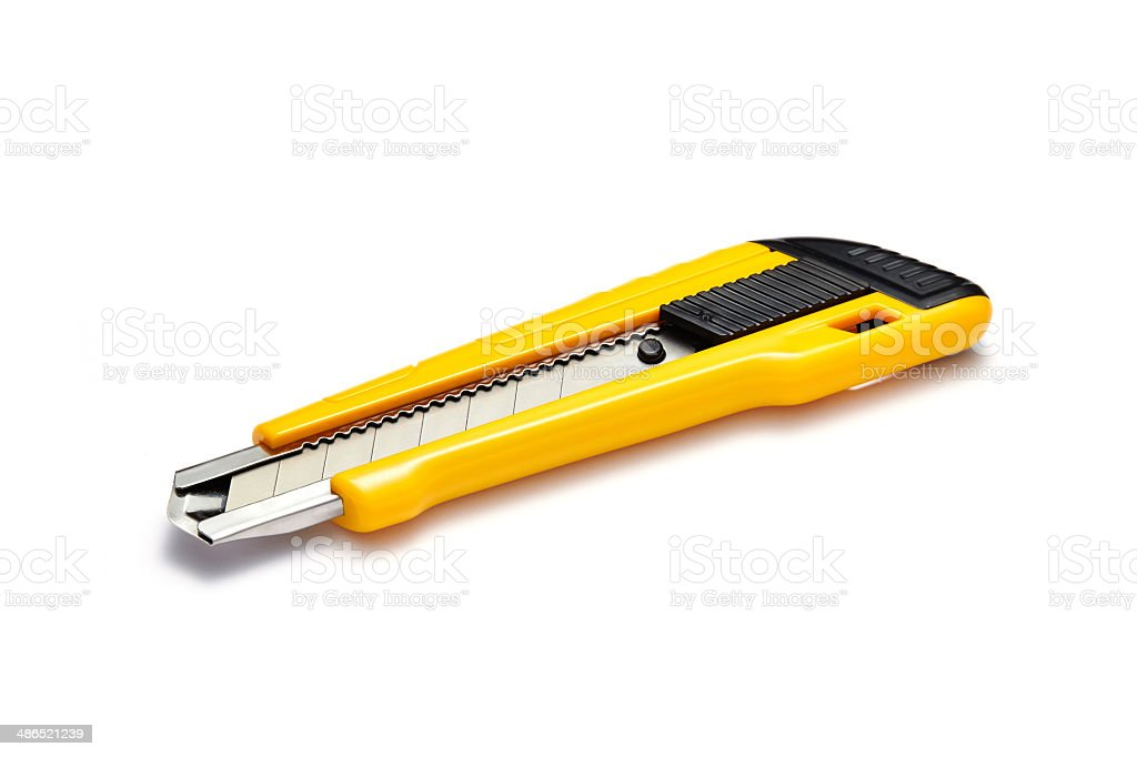 The yellow stationery knife isolated on white royalty-free stock photo