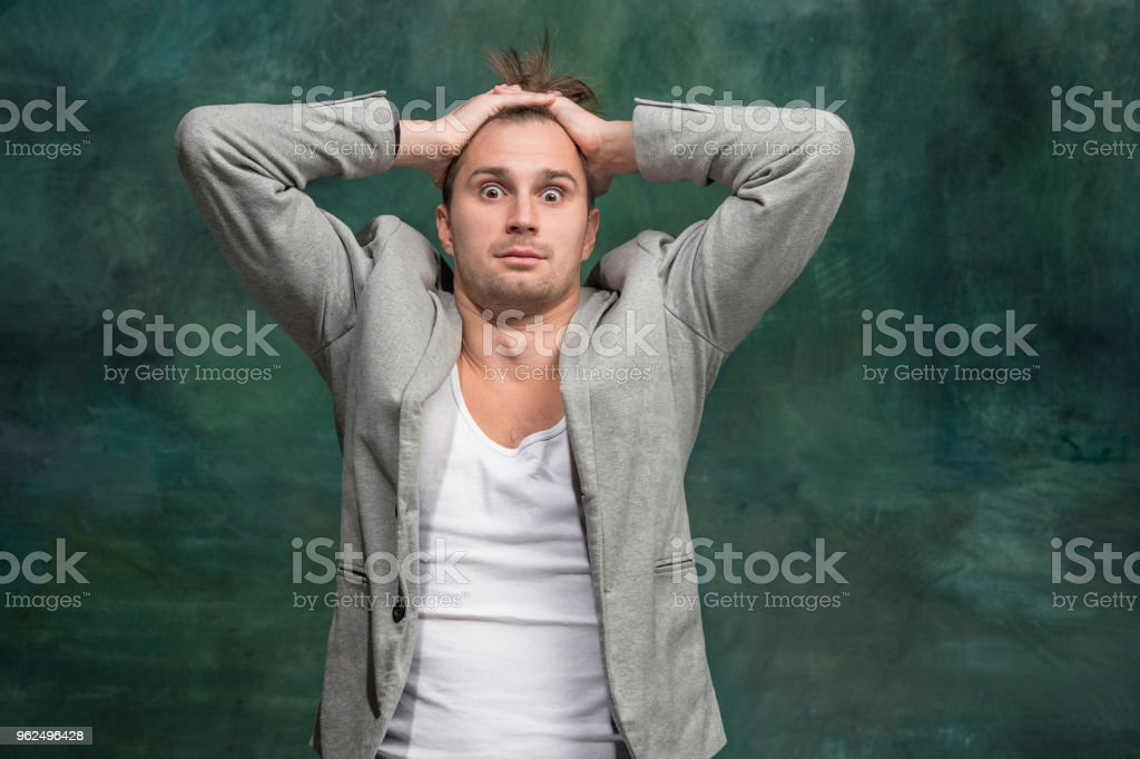 The young attractive man looking suprised - Royalty-free Adult Stock Photo
