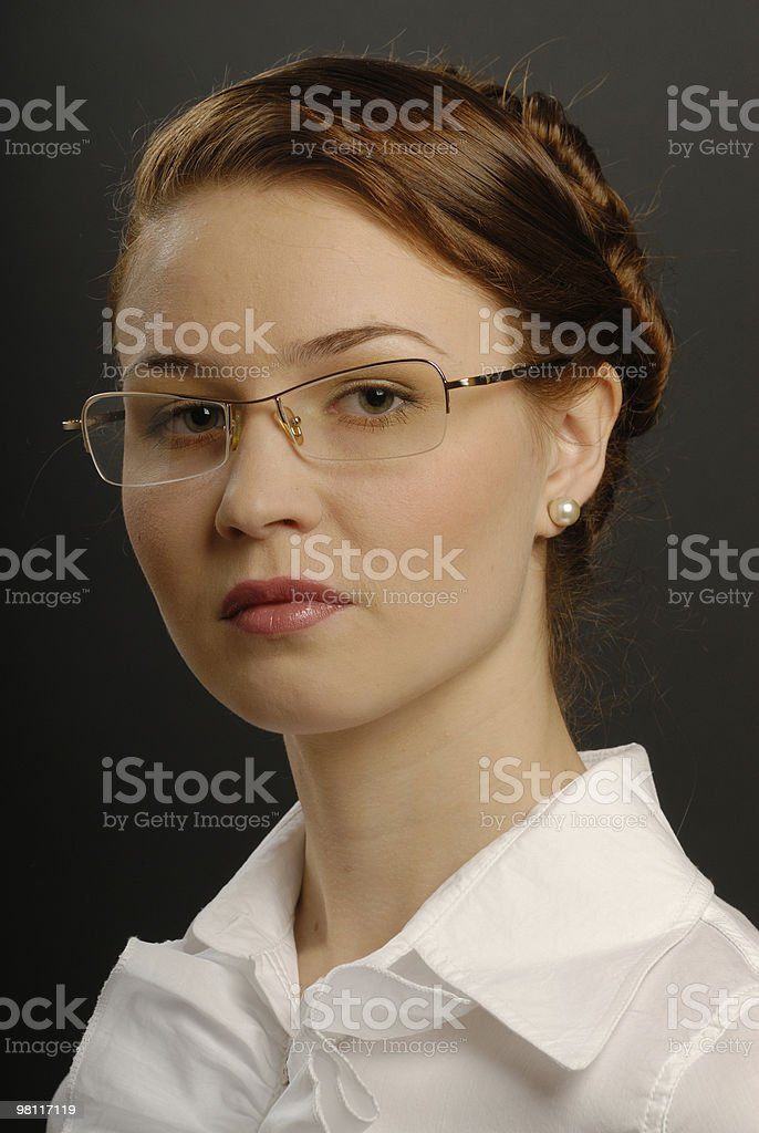 The young business woman in glasses royalty-free stock photo