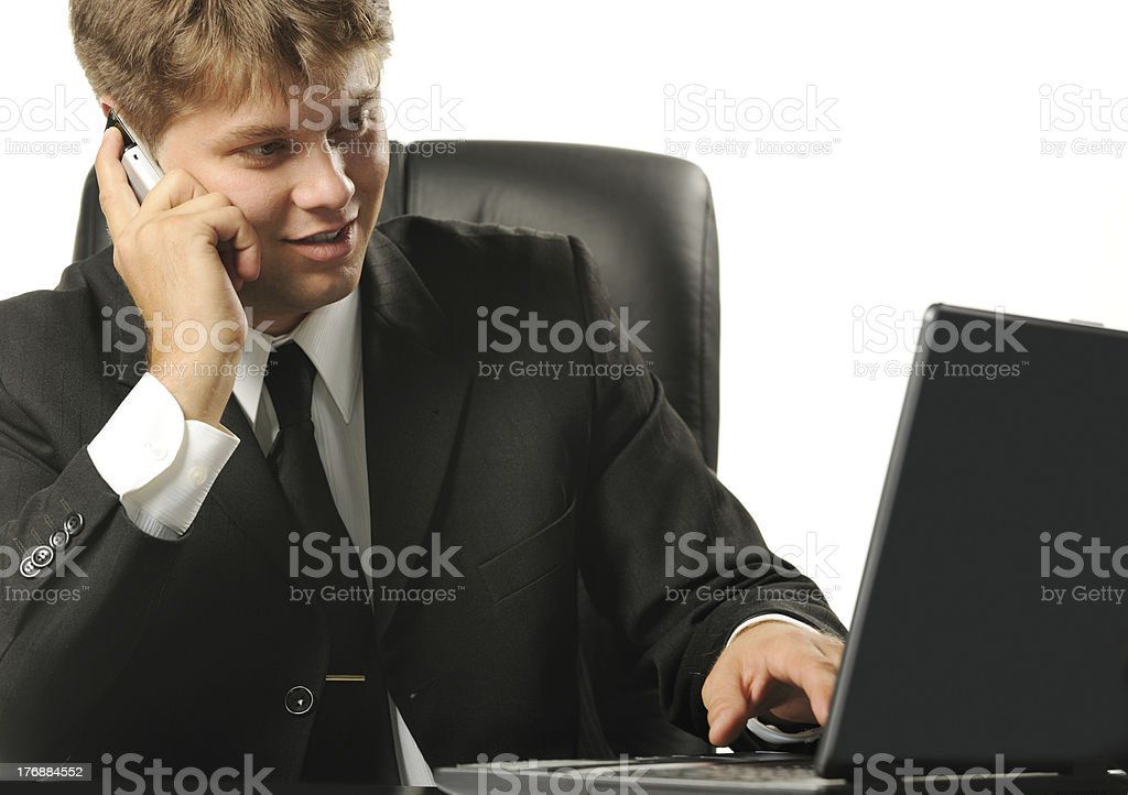 The young businessman on a workplace royalty-free stock photo