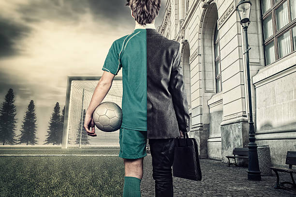 The young businessman Young man half soccer player half bussiness man. In a city and  soccer field. leisure equipment stock pictures, royalty-free photos & images