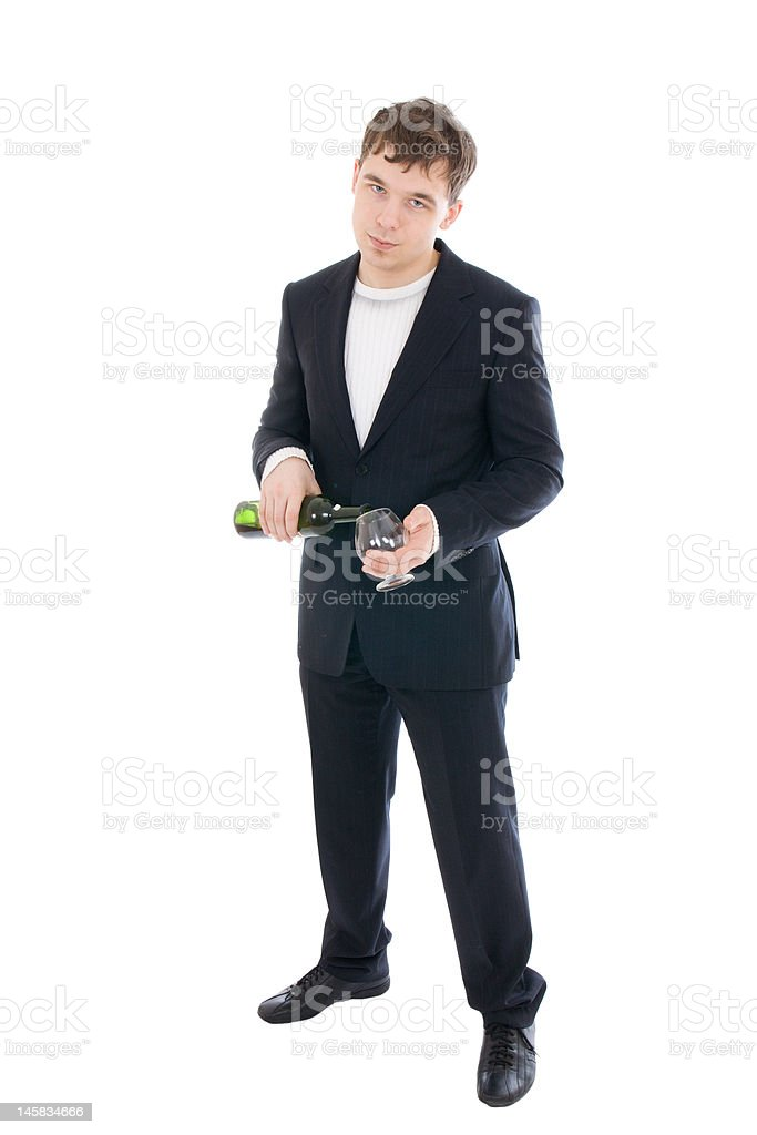 The young businessman with bottle of wine isolated royalty-free stock photo
