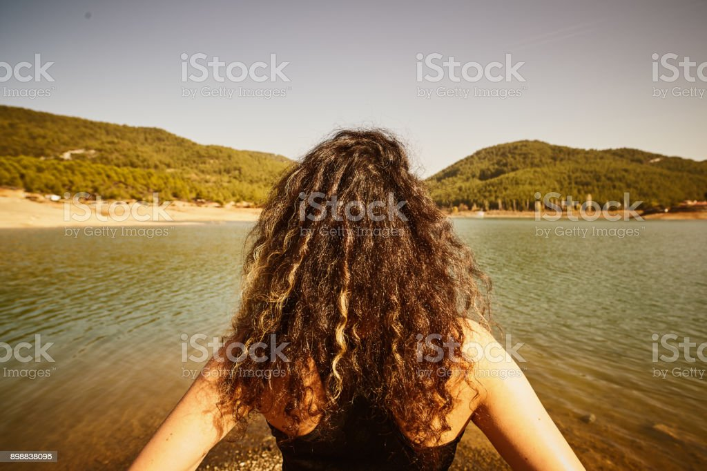 the young girl relaxation movements by the lake stock photo