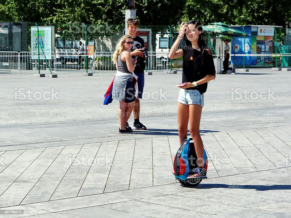 The young girl riding a Segway at National Olympic Park stock photo