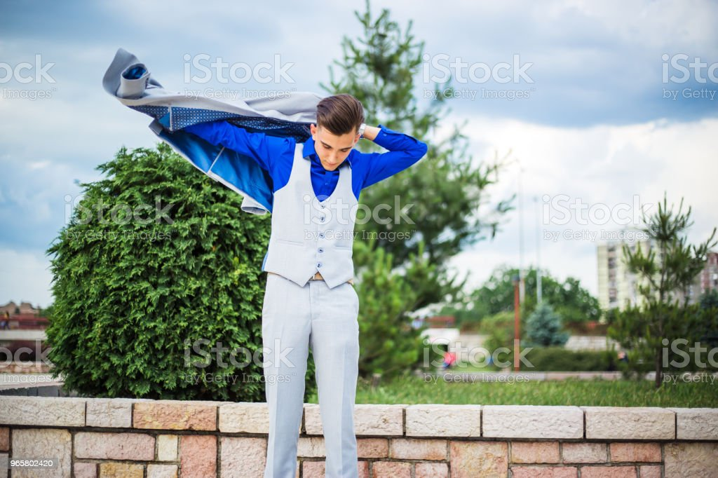 The young man dresses a jacket - Royalty-free 18-19 Years Stock Photo