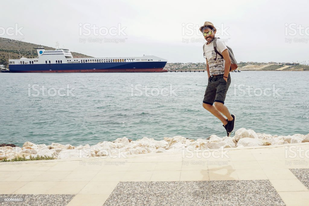 The young man jumping up with joy stock photo