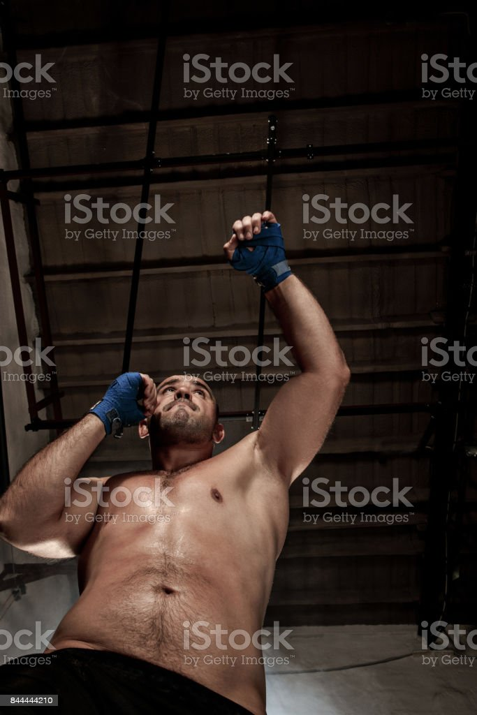 The young man kickboxing on black stock photo