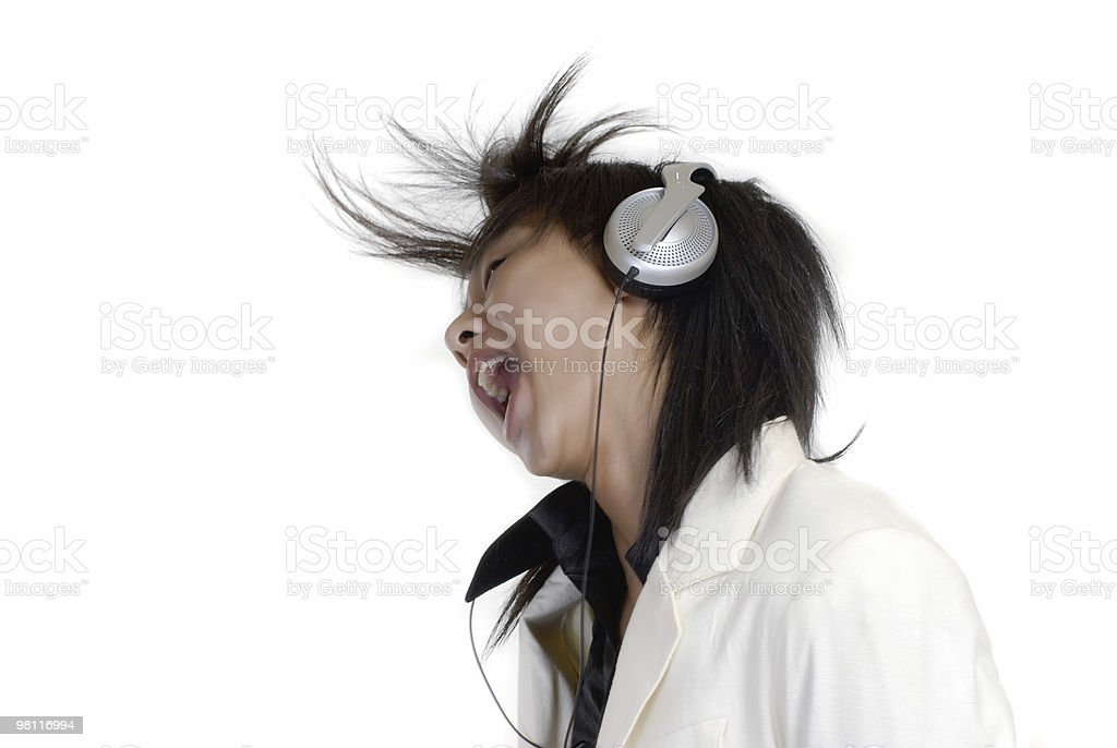 The young man listening to music royalty-free stock photo