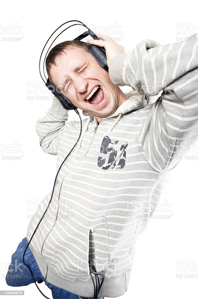 The young man listens to music royalty-free stock photo