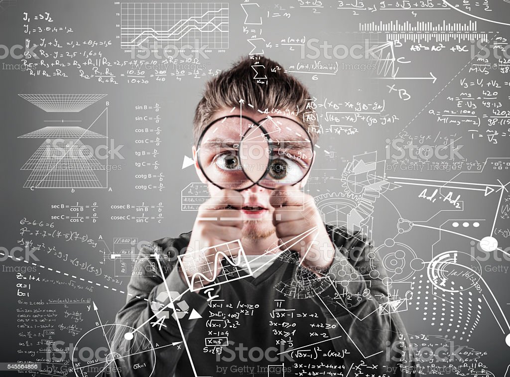 The young man with magnifying glass stock photo
