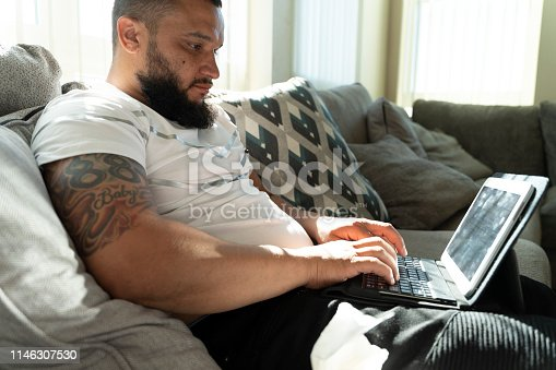 istock The young man working with a tablet 1146307530