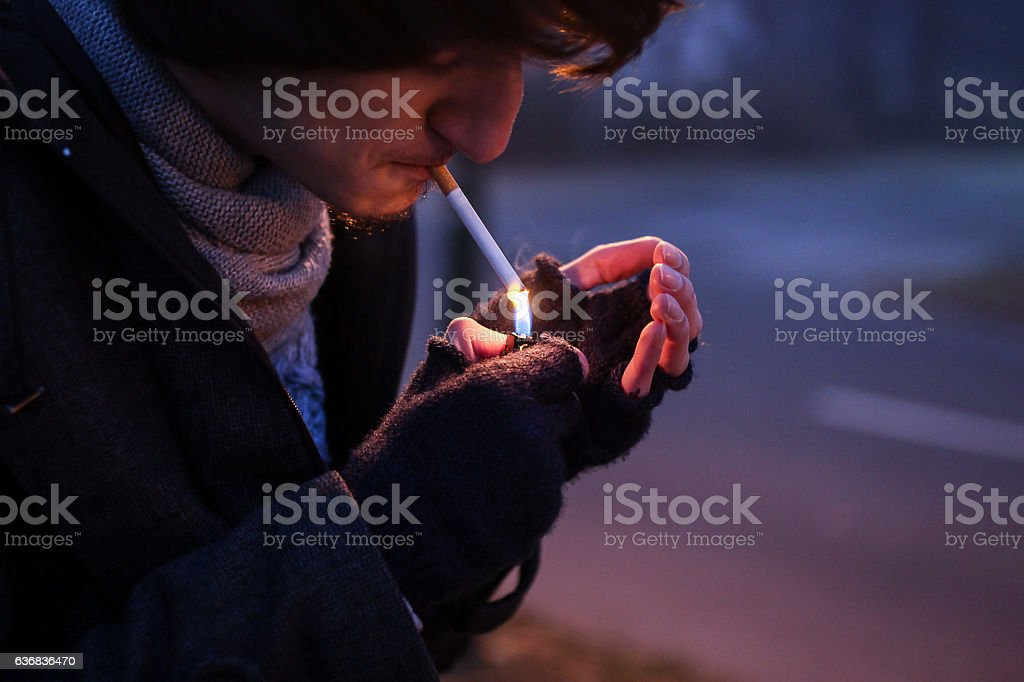 The young person smoking cigarette stock photo
