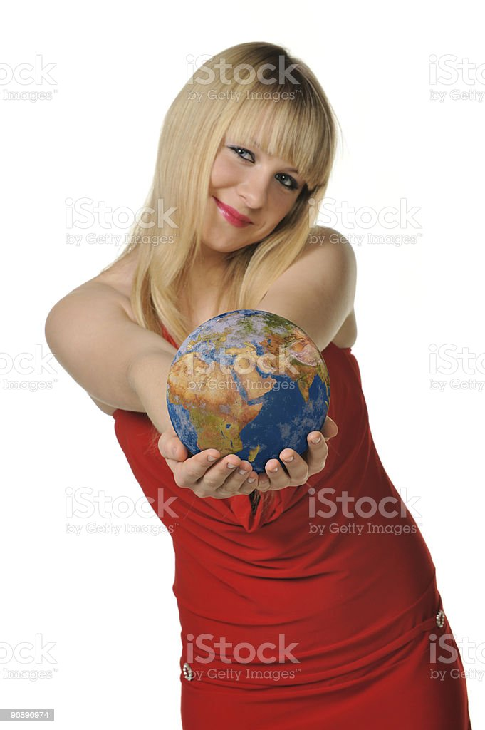 The young woman holds  globe in hands royalty-free stock photo