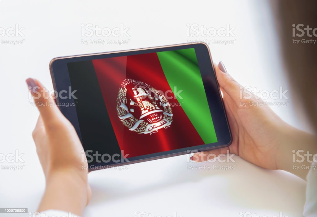 The Young Woman Is Using A Tablet Country Flags Visuals On