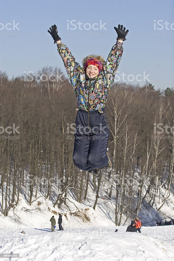 The young woman jumping royalty-free stock photo