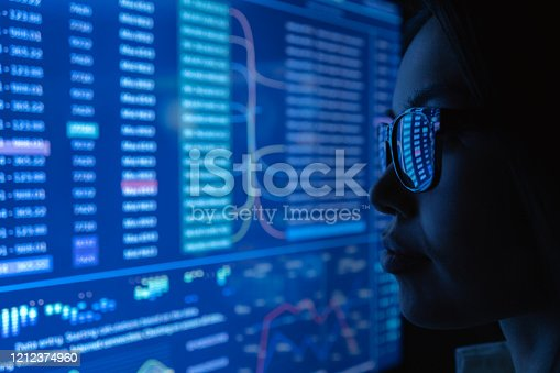 847519080 istock photo The young woman looking on a blue screen 1212374960