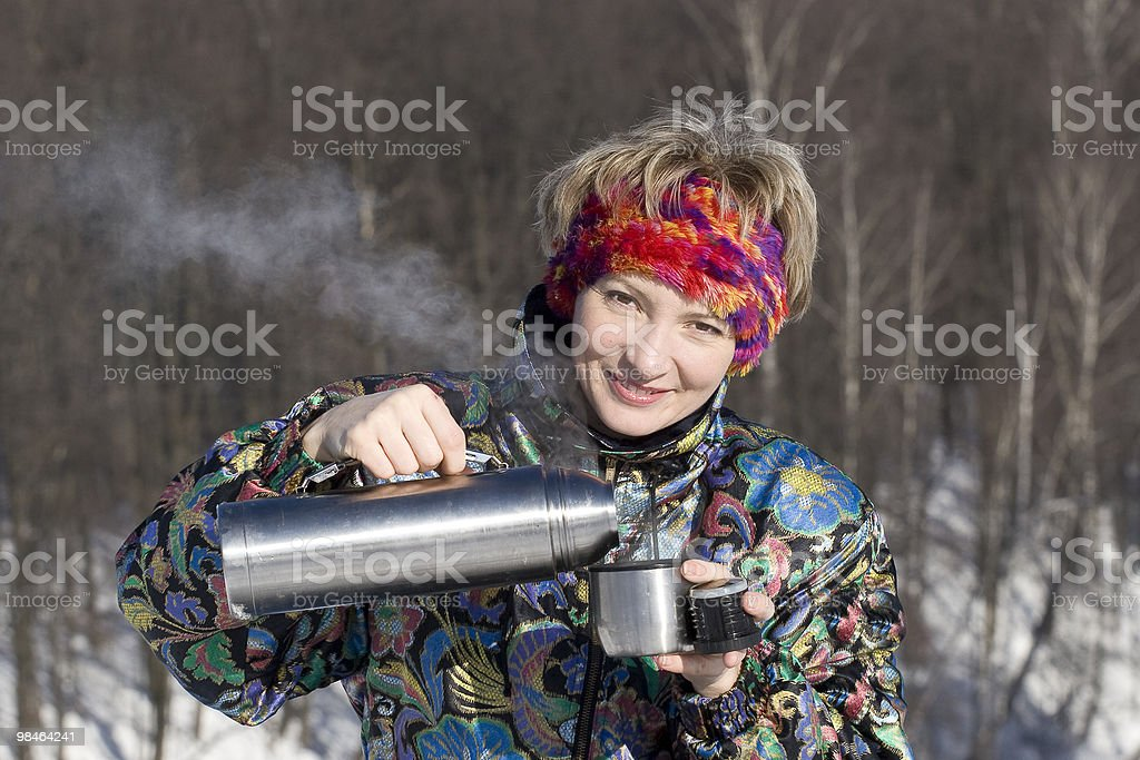 The young woman opens a pot royalty-free stock photo