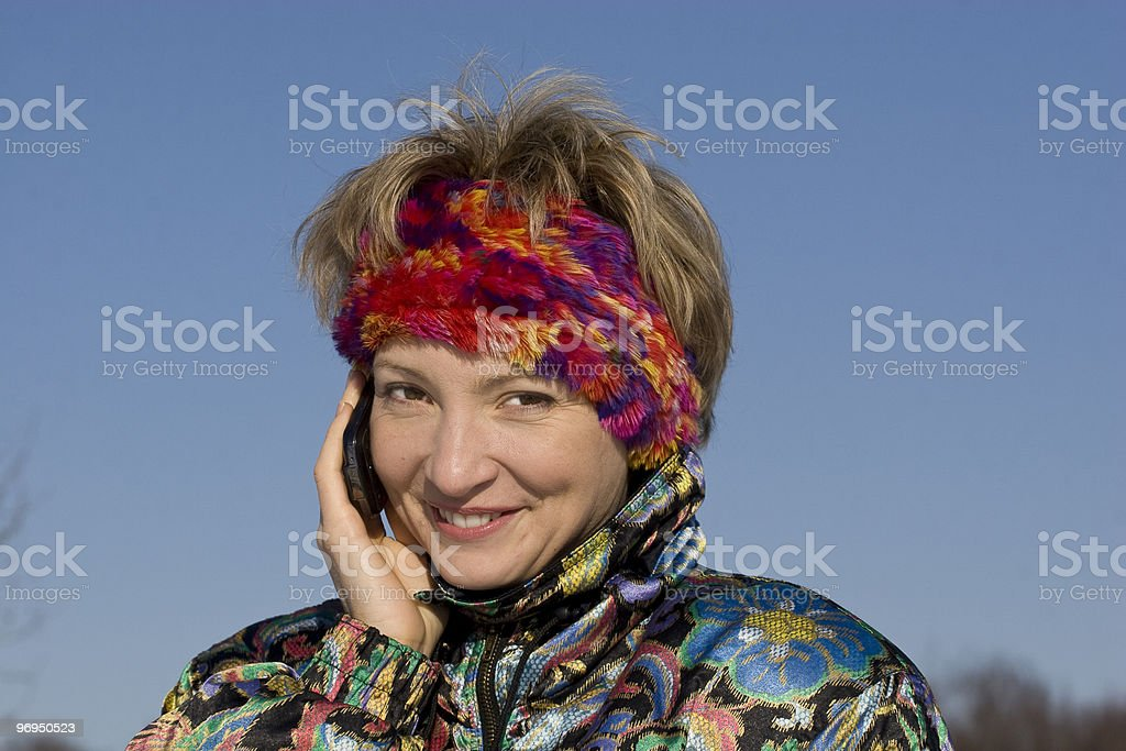 The young woman outdoor speaks royalty-free stock photo