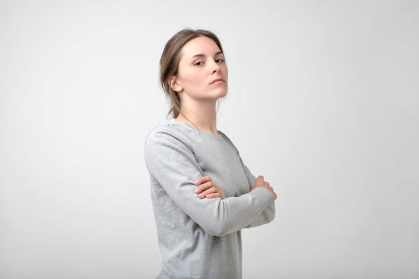 The young woman portrait with proud and arrogant emotions on face. The young woman portrait with proud and arrogant emotions on face. She is self proud and does not care about other people arrogant stock pictures, royalty-free photos & images