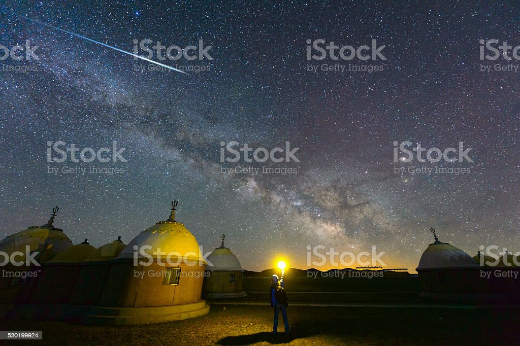 The Yurt under the milky way arch with meteor stock photo