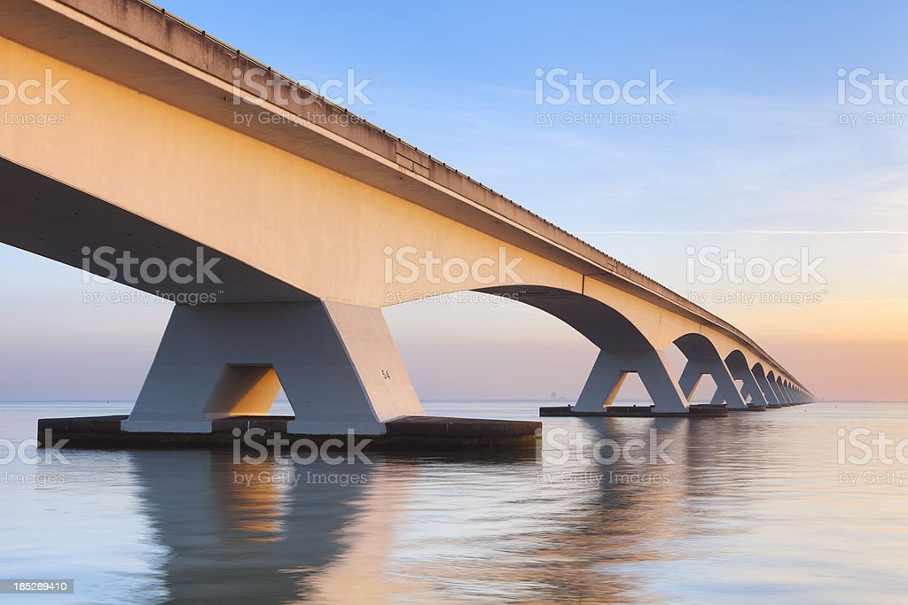 The Zeeland Bridge in Zeeland, The Netherlands at sunrise stock photo