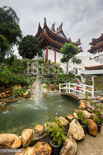 Kuala Lumpur, Malaysia - December 2, 2019: View of the Thean Hou Chinese temple in Kuala Lumpur Malaysia in cloudy weather. The fountain in the foreground.