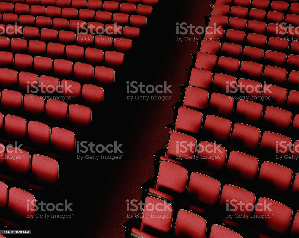 Theater aisle between red seats, overhead view  Absence Stock Photo