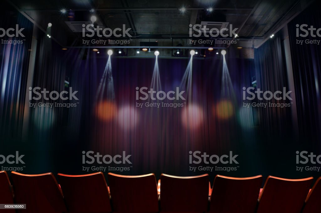 theater before showtime , empty auditorium with seats stock photo