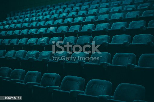 Plush, turquoise colored theater empty seats