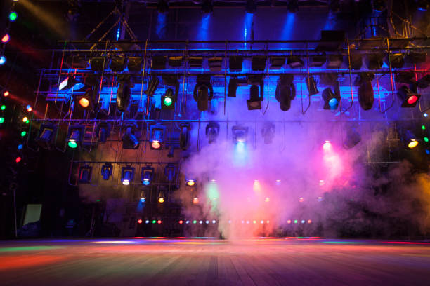 Theater light on stage Light effects on stage created with theatrical lighting equipment and a smoke machine performing arts event stock pictures, royalty-free photos & images