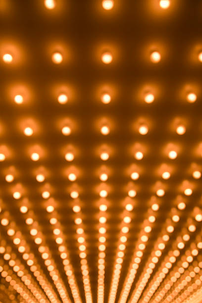 Theater Marquee Sign Lights at a Theatre Entrance Defocused stock photo