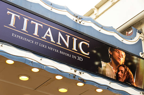 "Theater Marquee with Titanic 3D Movie Poster ""Los Angeles, California, USA - April 14, 2012: Poster of the movie Titanic 3D on the marquee of the Fox Village Theatre in the Westwood Village district. The film is the 3D version of the historical drama originally released in 1997, starring Leonardo DiCaprio and Kate Winslet."" westwood neighborhood los angeles stock pictures, royalty-free photos & images"