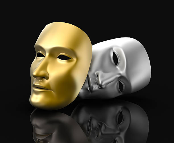 Theater masks concept. On black background. stock photo