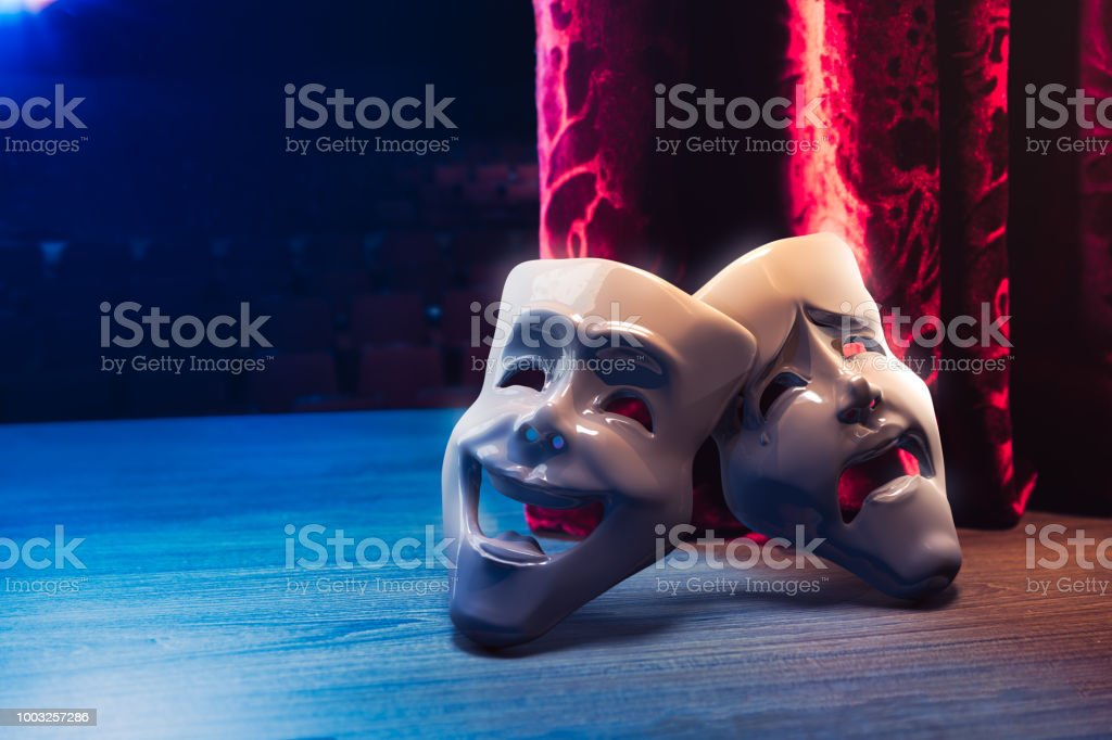 Theater masks in front of a red curtain/ 3D rendering Theater masks, drama and comedy with a red curtain as backdrop / 3D Rendering, Mixed media. Theatrical Performance Stock Photo