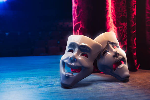 Theater masks in front of a red curtain/ 3D rendering Theater masks, drama and comedy with a red curtain as backdrop / 3D Rendering, Mixed media. performing arts event stock pictures, royalty-free photos & images