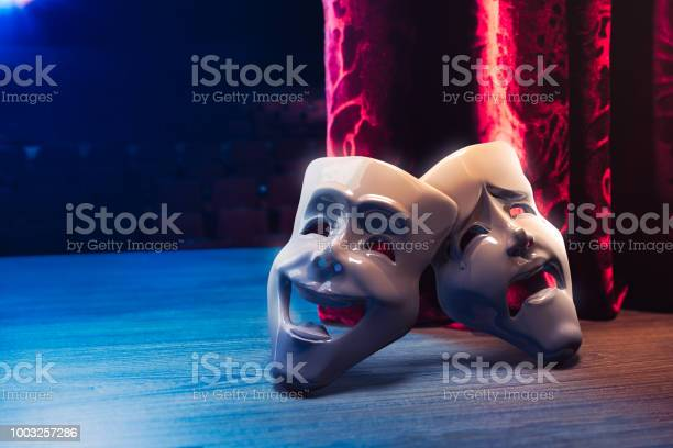 Theater Masks In Front Of A Red Curtain 3d Rendering Stock Photo - Download Image Now