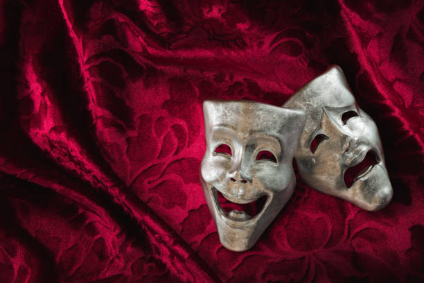 Theater masks over red curtain / 3D rendering stock photo