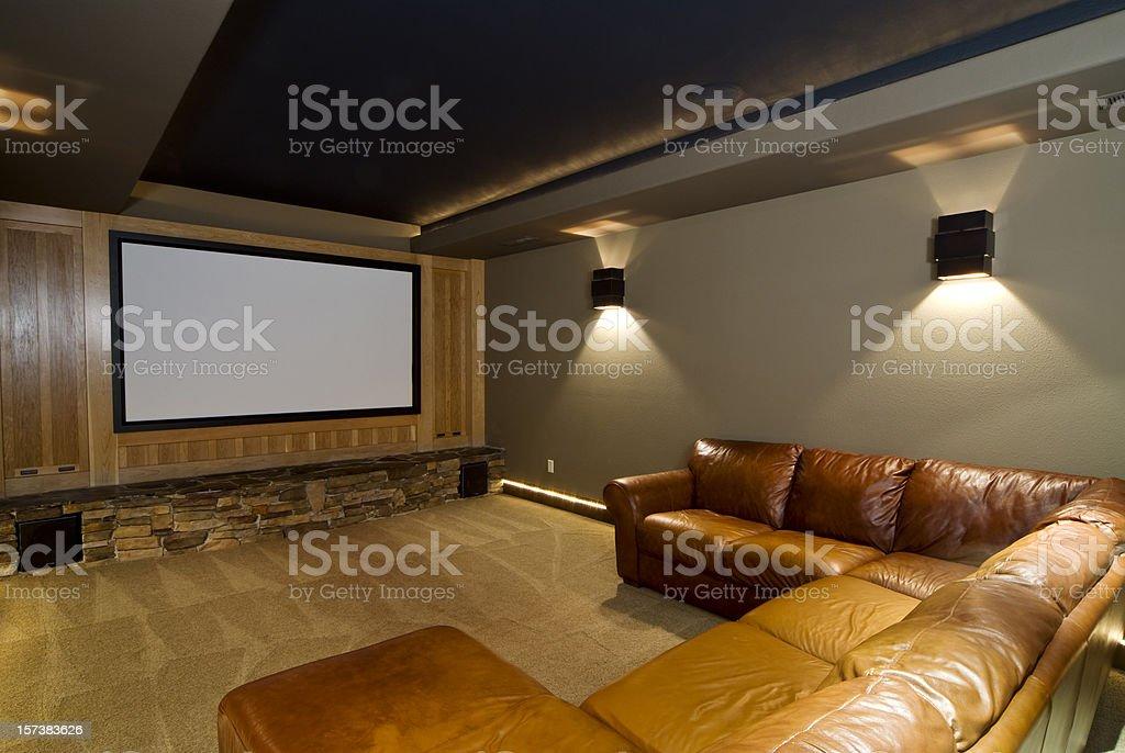 Theater room with large cushion U shape sofa stock photo