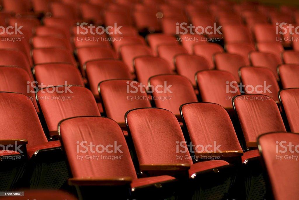 Theater Seats in an empty auditorium stock photo