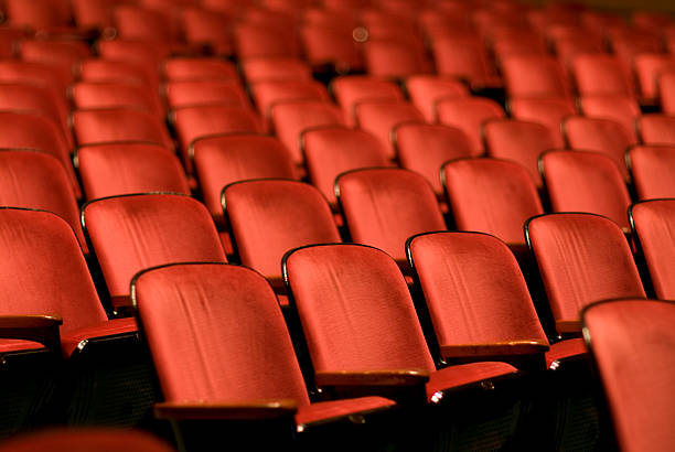 theater seats in an empty auditorium - film festival stock photos and pictures