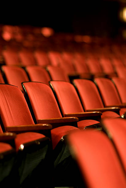 theater seats in an empty theater - film festival stock photos and pictures