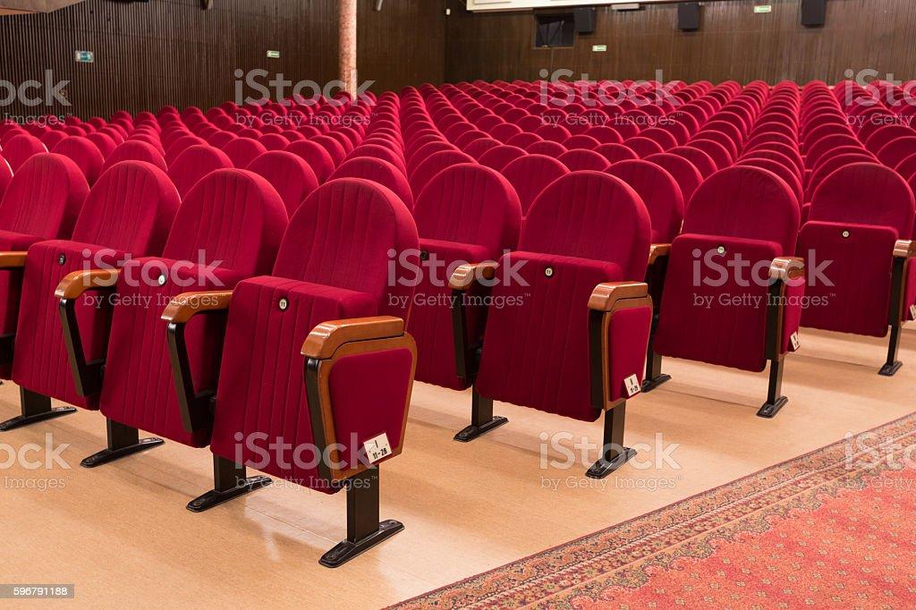 Theater seats Theater or movie seats, nobody. Auditorium Stock Photo