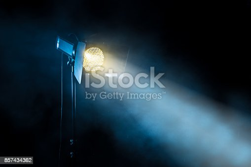 istock Theater spot light on black background 857434362