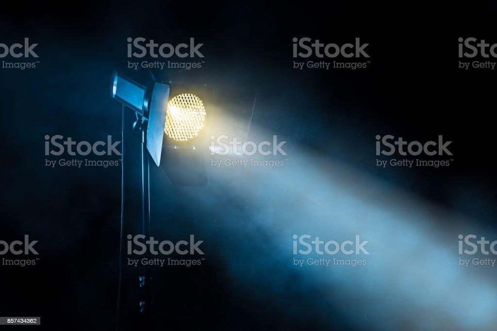 Theater spot light on black background stock photo