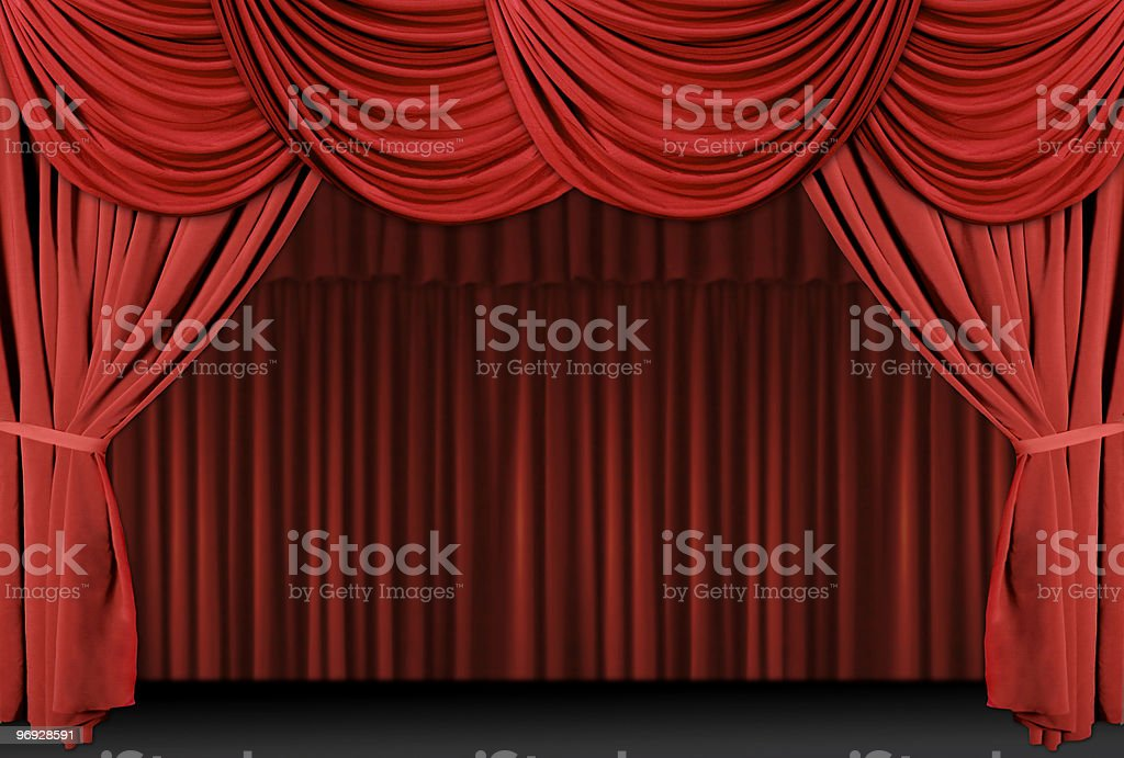 A theater stage draped with red curtains royalty-free stock photo