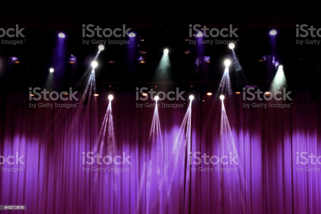 theater stage with purple curtains and spotlights. stock photo