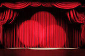 istock Theater stage with red velvet curtains and spotlights. 1220793403