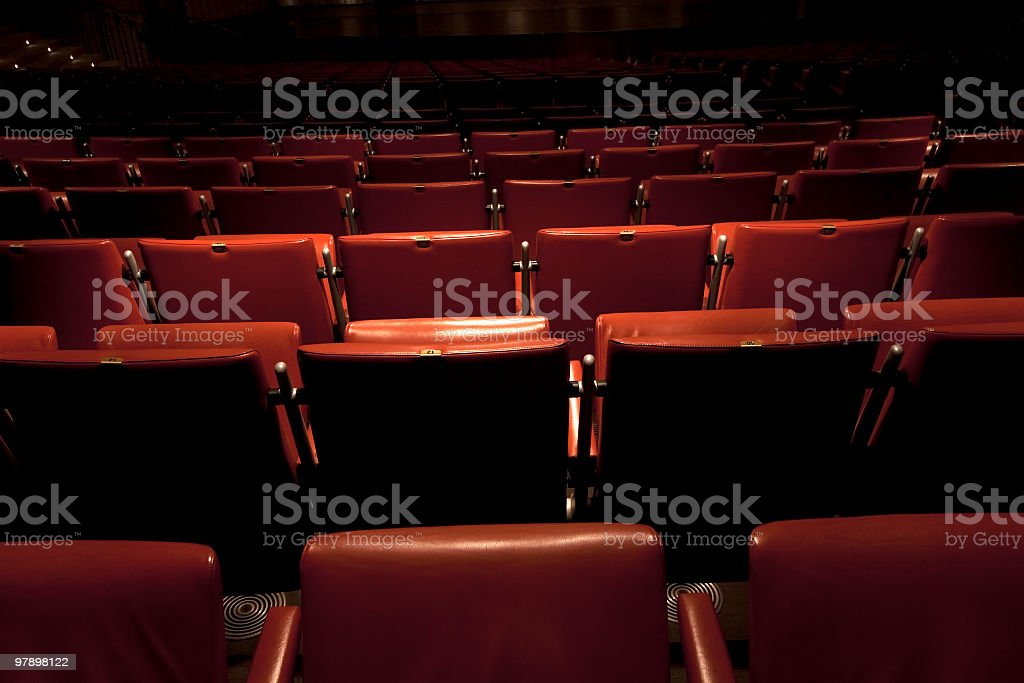 Theater with red leather seats royalty-free stock photo